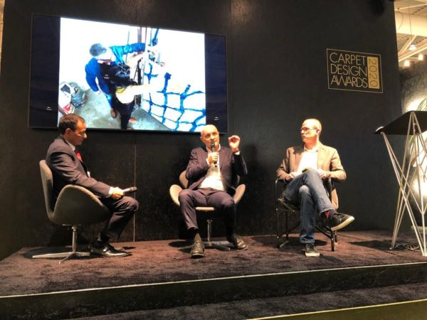 The panel discussion at Domotex with Dev Sarawagi, Giulio Bonazzi, and Michael Christie.